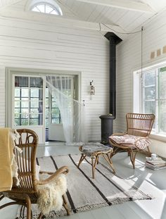 Home Interior Pictures my scandinavian home: A Photographer& Charming Swedish Summer Cottage In The Woods - white wood panelling in the living room with rattan furniture and wood burning stove. Scandinavian Home Interiors, Scandinavian Living, Cottage Kitchen Renovation, Summer House Interiors, White Wood Paneling, Swedish Cottage, Wood Cottage, Cottage In The Woods, Lakeside Cottage