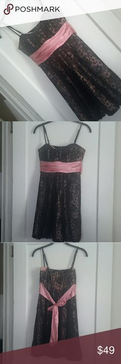 Romantic Black & Pink Lace Prom Dress Bubble hem dress Pink satin with black lace overlay Satin Ribbon bow that ties in back Approximate Measurements  (laid flat): Length 24 inches from under arm to hem, Bust 14 inches (28 inches around), Waist 15 inches (30 inches around), Hips 18 inches (36 inches around) Original tags still attached Speechless Dresses Prom