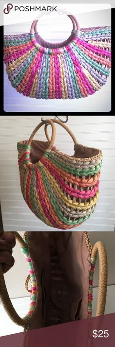 """Rainbow Color Basket Purse Rainbow Color Basket Purse  Width 19""""  Handle to bottom 15""""  Opens 8"""" Wide Measured from side to bottom 9"""".   The handles 7"""" Wide  all measurements are approximately but really close Too cute carried once  .Wear with everything. Sundresses jeans dress pants. Tiny hole in the inside see pic. You don't notice it the hole. Bags"""
