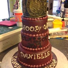 An Aggie graduation cake, topped with the Aggie Ring.