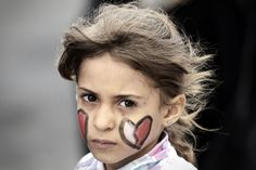 A Bahraini girl takes part in an anti-government protest in solidarity with jailed activists and in celebration of Mother's day in the village of Abu Saiba, west of Manama, on March 21, 2014.