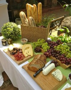 French-inspired hors d'oeuvres, simple bread and cheese, and lots of grapes for wine! Love the baguettes in basket for height. More