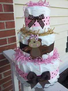 3 Tier MONKEY diaper cake decorated with Pink & brown polka dot ribbon is placed in a cake cardboard, it can be used for a baby shower centerpiece or present.    $26.49