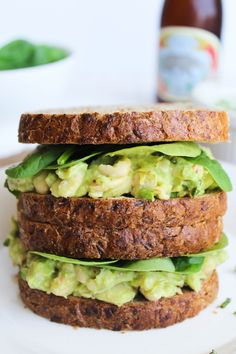 This Smashed White Bean, Basil, & Avocado Sandwich takes about 5 minutes and 5 ingredients for a quick and easy weeknight dinner! {vegan, gluten free}