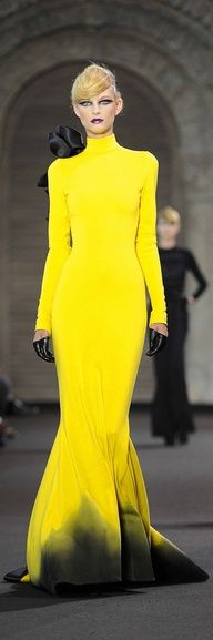#Yellow long-sleeved, turtle-neck, floor-length gown with black detailing