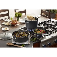 """Set includes: 10"""" and 12"""" open omelet pans, 1.5-qt. and 2.5-qt. covered saucepans, 3-qt. covered saute pan, 5-qt. covered Dutch oven, and 8-qt. covered stockpot"""
