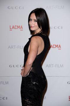 Emily Blunt booty in a sleeveless black dress