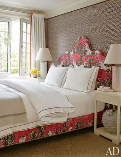 grasscloth, white drapes with trim, patterned upholstered bed.