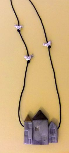 Polymer clay and silver bird bead pendant. *