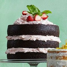 Dark Chocolate Cake with Fresh Strawberry Buttercream This fudgy dark chocolate cake is stacked tall and filled with fluffy strawberry frosting. Brownie fans will love the texture; strawberry fans will adore the icing.