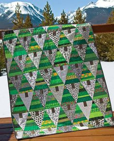 Tree Farm Quilt  - I think this would be pretty snazzy as a panel for the holidays, with some appliqued or embroidered ornaments, some metallic thread for tinsel, etc.