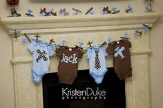 I love the clothes line with the baby clothes for decor...once again mommy and daddy could put the clothes to use after the party!