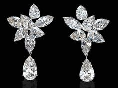 A PAIR OF DIAMOND EAR PENDANTS, BY HARRY WINSTON   Each pear and marquise-shaped diamond cluster suspending a pear-shaped diamond weighing approximately 2.66 and 2.86 carats, mounted in platinum  with maker's mark for Harry Winston