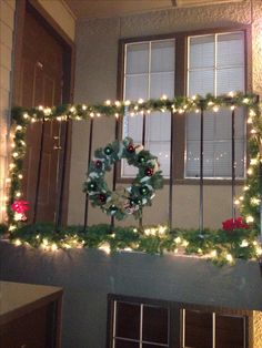 small space decorations ideas for outside christmas decor for condo or apartment dyi railing decorated with garland clear lights and two poinsettias at - Apartment Balcony Christmas Decorating Ideas