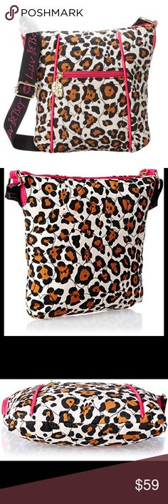 """🆕 Luv Betsey Cassie Crossbody bag animal print Super lightweight and fashionable this fun Luv Betsey crossbody bag is perfect for everyday use.  Canvas adjustable strap with Luv Betsey hot pink repeated logo Zip top closure Exterior: gold-tone hardware, front zip pocket with lips-shaped charm on zipper featuring Luv Betsey logo, heart-stitched quilted texture, hot pink piping detail, leopard print Interior: back wall zip pocket, two front wall slip pockets, fully lined Dimensions: 8.5""""L x…"""