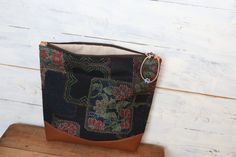 "Special Sale ///This beautiful Kimono × Leather Fold over Clutch bag is made of Japanese Vintage beautiful flower pattern on Dark navy Kimono Fabric ( wool ) "" Kasuri "" with Beautiful Italian brown leather."