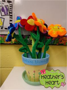 Kindness Recorder looks for kind acts to add a kind flower to our flower pot.
