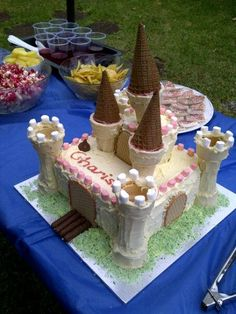 Like this variation of the princess castle cake.  Uses lots of iced cones and marshmallows.