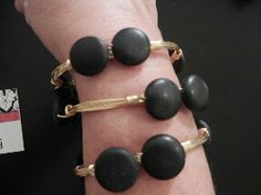 Matte black stones on a gold bangle is a staple piece that can be matched with any Roc Me Out bangle. Mix and match with bright colors or stack up black bangles for a classy look.