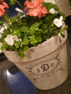 #springintothedream  Front Porch Inspiration:  Aged and Monogrammed Flower Pot.  Uh oh, now I stumble across this ... and I thought I was done fussing with my flower pots ...