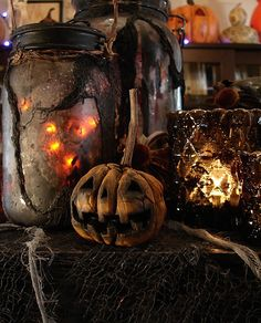 old jars, candle holders and pumpkins for halloween.