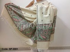 Cream color Tassar Dupatta with Red & Green Peacock motifs painted on both sides of Pallu. This form of Madhubani where the patterns are created by using only lines is known as Line Painting. Size: L*W (2.25 mtr *1 mtr)