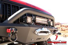 Front heavy-duty bumper with a Warn M8000 winch