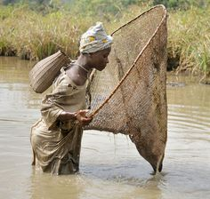 Africa | Fishing in the river. Village life in Gbolokai, Liberia.  | © Christopher Herwig