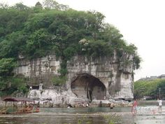 The Elephant Trunk Hill stands in the downtown area of Guilin city, Guangxi Province of China, at the junction of the Li River and the Peach Blossom River. Description from unibesizydur.keep.pl. I searched for this on bing.com/images