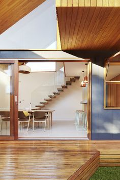 Triangular void joins a timber extension to a Melbourne home.