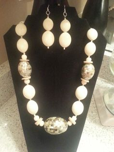 Beige polished beads necklace and earrings set.