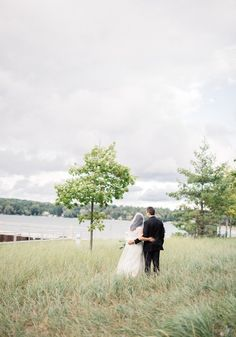 Gorgeous traditional Michigan wedding: Photography: Keen And Kind - http://www.stylemepretty.com/portfolio/keen-and-kind Read More on SMP: http://www.stylemepretty.com/2017/01/10/event-planners-wedding/