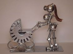 Robot mother and baby sculpture.