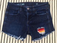 Dark rinse j. crew hand patched cutoff jean shorts with serape and vintage huipul embroidery patching.  One of a kind and festival ready!  Boho perfection, size 29 waist.