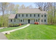 OPEN 9/14 from 1-3PM! 11 Old Farm Hill Road, Newtown, CT 06470 — Warm & Inviting four bedroom 2 1/2 bath colonial in a wonderful Newtown neighborhood!  This meticulosly maintained home has had many updates and improvement over the years. The kitchen has beautiful cabinetry, plenty of granite countertops, stainless steel appliances and a wet bar for easy entertaining both indoors and out. Walk out to an oversized deck from both the kitchen and the spacious family room