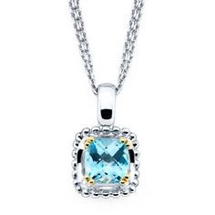 Stunning Cushion Cut Blue Topaz Pendant set in Sterling Silver with 18k Yellow Gold.