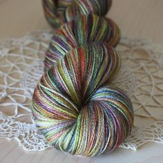 """One of a kind skein of merino/silk laceweight yarn, hand dyed by Phydeaux Designs - I really like the yellow in this skein, part of my """"nebulae"""" series of unique laceweight colorways (glowing colors against a dark background).  :)"""