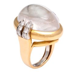 DAVID WEBB Rock Crystal & Diamond Ring. Some of Webb's finest work was with rock crystal, and this fantastic ring is no exception. The voluminous rock crystal cabochon is backed with highly polished platinum, resulting in a wonderful ball of light. The diamond accents on each side complete the bold look of this infamous cocktail ring.