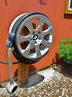 BMW Hub Cap upcycle - Hose Reel Upcycle Car Parts - Reuse Recycle Repurpose DIY using parts from Cars, Motorcycles, Trucks, and more. We carry all kinds of car parts at ! Outdoor Projects, Garden Projects, Home Projects, Pvc Pipe Projects, Metal Art Projects, Garden Tools, Garden Hose Storage, Garden Hose Holder, Garden Art
