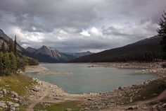 """Medicine Lake is located in Jasper National Park, Alberta, and it is part of the Maligne Valley watershed which is mainly glacial fed. Medicine Lake is approximately 7 km (4.3 mi) long and is a relatively shallow lake. Because medicine lake is not an actual lake but more of an area in which the Maligne River flows, the lake """"dissapears"""" during the winter, turning into a meandering frozen river. In the 1970s, researchers used a biodegradable dye to determine the underground river's extent…"""