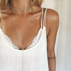 || Loving the layered look today // featuring the Bali choker, Briana choker, and Clear Crystal Backless Necklace worn in the front xx . . . . . . . . . . . . #necklayers #choker #gypsy #gypset #festivaljewelry #goldjewelry #goldchain #giveback #oceanconservation #donate #beachlife #madeincalifornia #madeinla #bohemian #boholuxe #bohochic #jotd #beach #saltyhair #mermaid #coachellastyle #backless