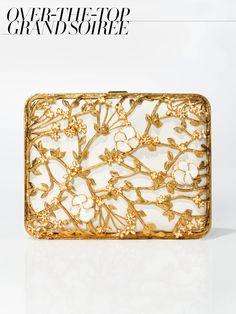 Alexander McQueen Bible Book Rigid clutch in Black and Gold (similar style), $3,975Alexander McQueen, NYC, 212.645.1797