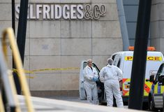 Police forensics officers work outside Arndale Centre shopping complex in Manchester, northwest England on October 11, 2019, following a series of stabbings. - Police arrested a man on terror charges Friday after a mass stabbing at a shopping centre in Manchester, northwest England, that left five people injured. The man in his 40s was 'lunging and attacking people' with a large knife in the Arndale shopping centre, Police Chief Russ Jackson said. (Photo by Lindsey Parnaby / AFP) (Photo by…