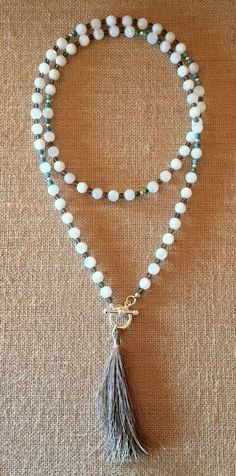 Beautiful milky white Moonstones, rich Smokey Quartz and Turquoise comprise that Mala-Styled Necklace, finished with a handmade Silk Tassel, hanging from a silver Toggle Clasp. Wear Long or doubled. N