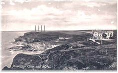 Photo of the old Polurrian hotel before it burnt down also showing the Marconi towers at Poldhu radio station  circa1904