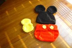 Hand crocheted black mouse beanie/cap/hat with big round ears, bright red diaper cover/shorts with bright yellow buttons & booties. Great for gift giving, baby's debut, first photograph