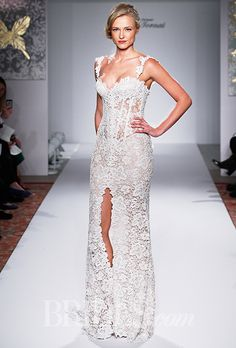 A lace #weddingdress with a high slit | Brides.com