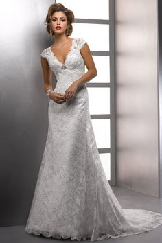 Vintage lace with scalloped detail along deep v-neckline transforms simple style into stunning beauty. via Project Wedding