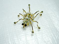 Vintage 1970's Rhinestone Gold Tone Spider Brooch by VisionsOfOlde, $18.00