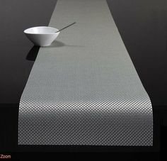 """Chilewich Basketweave Table Runner Ice by Chilewich. $58.00. The Chilewich table runners are washable and stain resistant, impervious to spills and suitable to virtually any space. Approximate dimensions: 14"""" X 72"""". The Basketweave Plynyl Table Runner by Chilewich, designed by Sandy Chilewich, is a modern alternative to tabletop dressing that is low maintenance, elegant, and affordable. The Chilewich table runners are washable and stain resistant, impervious to spi..."""
